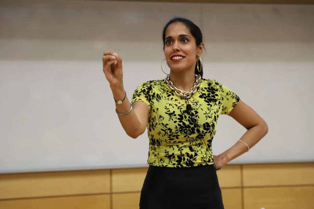 Ritu Bhasin speaking in an event as a keynote speaker