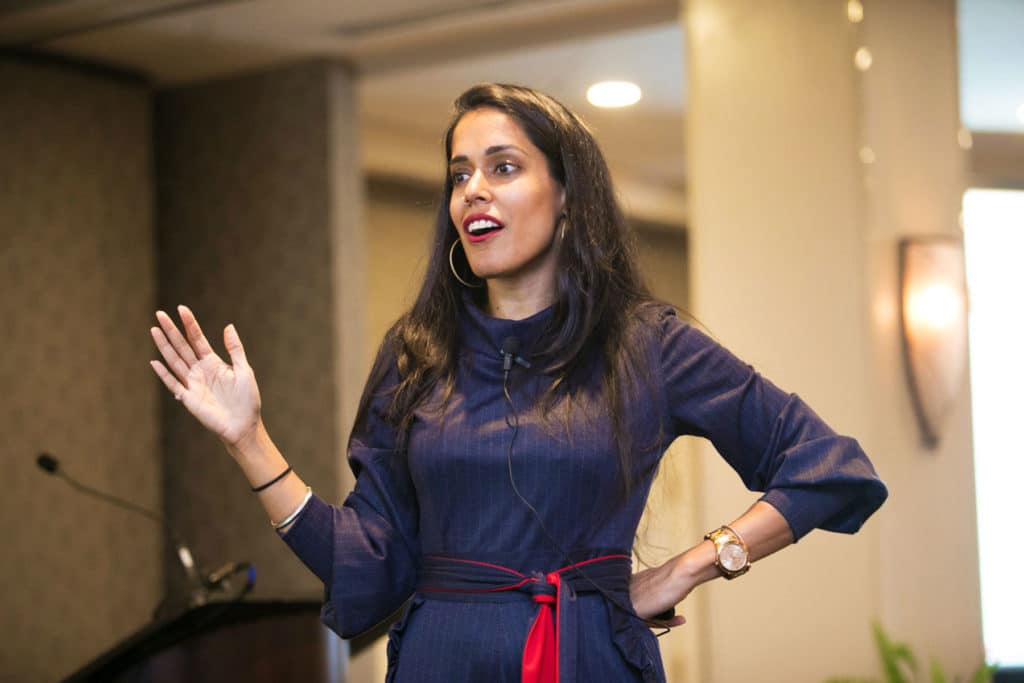Ritu Bhasin delivering a keynote speech
