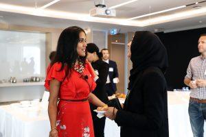 Ritu Bhasin speaking with a Muslim woman