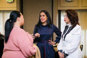 Ritu Bhasin speaking with two women about allyship